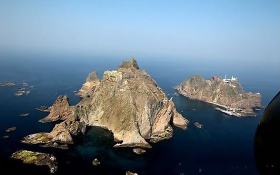 Japan extends claims to Dokdo in high-speed train poster
