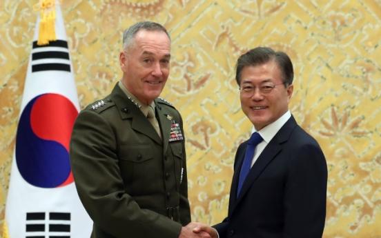Moon breaks silence, urges North Korea to halt threats