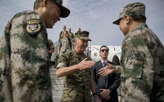 China tells US, North Korea to 'hit the brakes' on threats