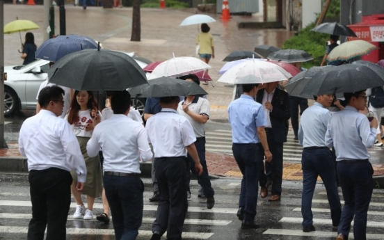 South Koreans work second-longest hours in OECD for below average pay