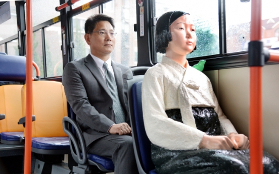 [Herald Interview] How comfort women statues got to ride Seoul buses