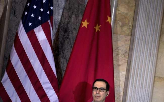 China urges US to drop new sanctions on Chinese companies
