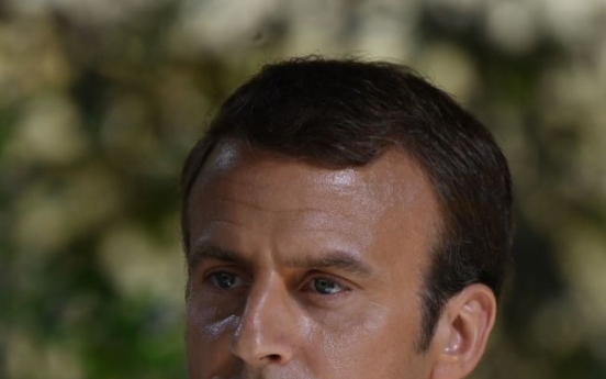 France's Macron in Romania for talks on 'posted workers'