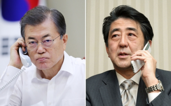 Moon, Abe agree to peaceful solution to North Korea's provocations