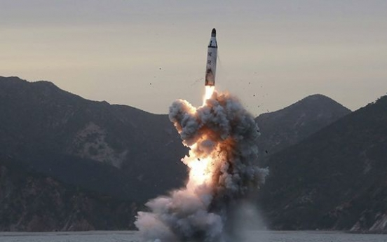 N. Korea fires projectile over Japan in aggressive test