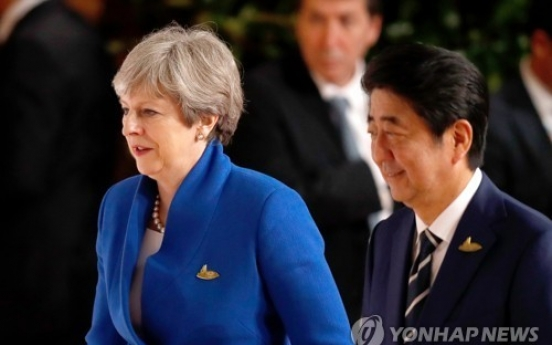 UK PM 'outraged' by N. Korea missile ahead of Japan trip