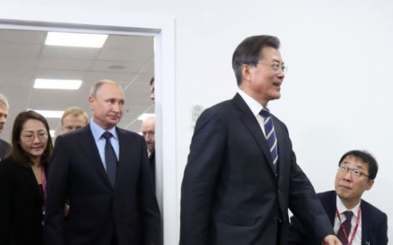 Putin 'casually late' for summit with President Moon