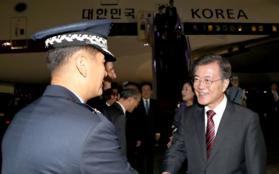 Moon returns home after Russia visit