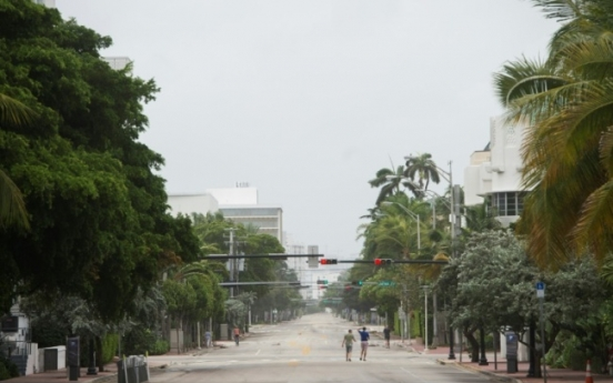 Irma lashes Florida, evacuees brace for strike