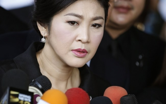 Ex-Thai leader sentenced in absentia to 5 years in prison