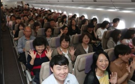 Koreans give themselves low scores on travel etiquette