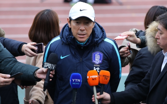S. Korea football coach vows to beat Japan, defend regional title