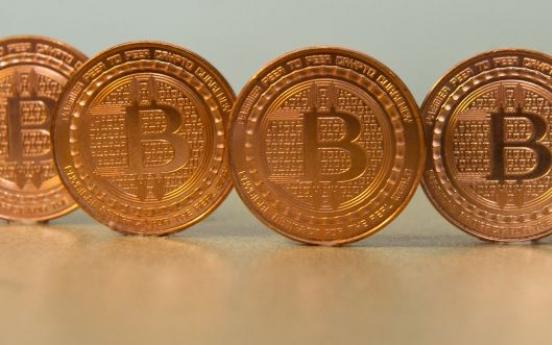 UBS boss says bitcoins 'not money', urges regulators to act