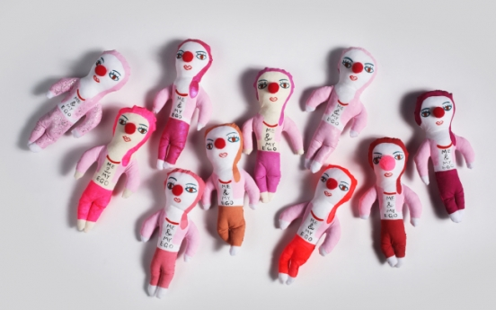 Artist 'instantly sews' thoughts, feelings into rag dolls