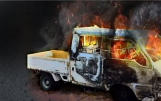 Suspect arrested for burning truck after fighting with wife