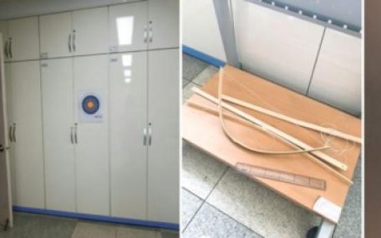Vice principal shoots arrow at female teacher