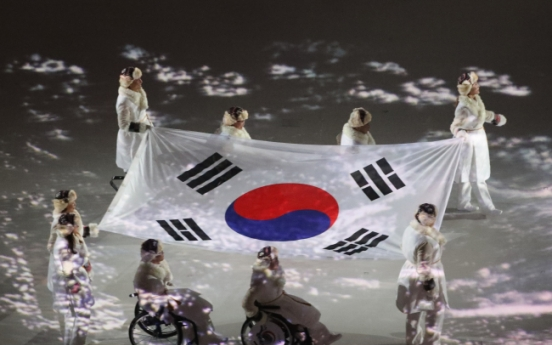 S. Korean Paralympic heroes bring national flag into opening ceremony