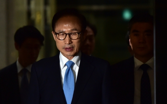 Ex-President Lee admits to receiving illicit money from state spy agency