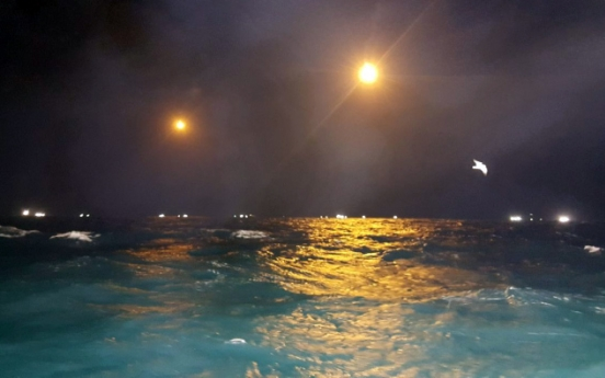 Men booked for scuba diving at night without safety equipment