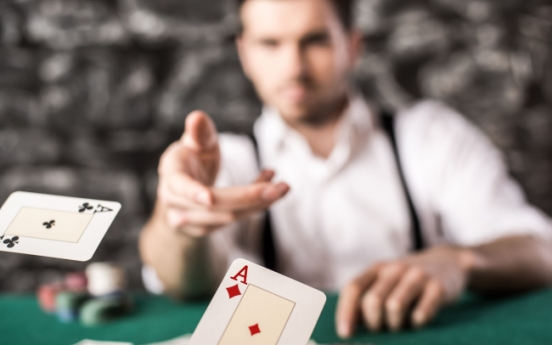 Man arrested for using penalty poker to assault 3 people