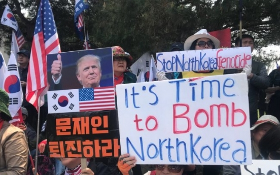 [From the scene] Rightwing protestors claim 'time to bomb NK'
