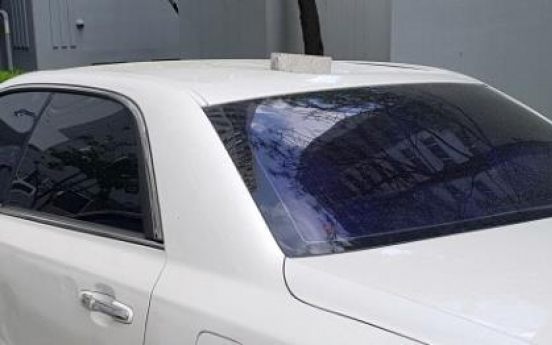 Brick drops on top of car from apartment building