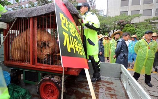 Dog meat farmers protest for survival rights near National Assembly