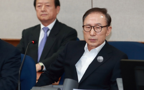 Ex-President Lee denies corruption charges at first hearing