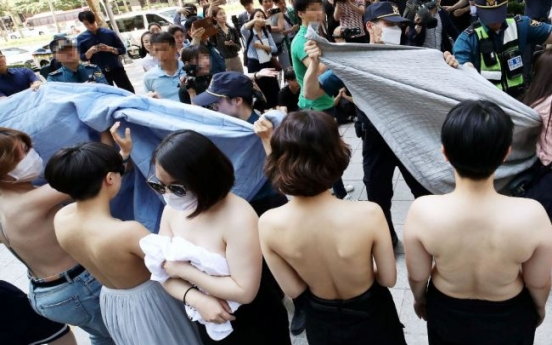 Feminist activists protest topless, Facebook Korea apologizes