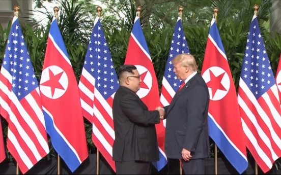 [US-NK Summit] Trump, Kim shake hands to open momentous summit