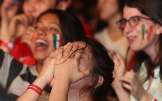[Photo News] Raw display of emotion at World Cup cheer site