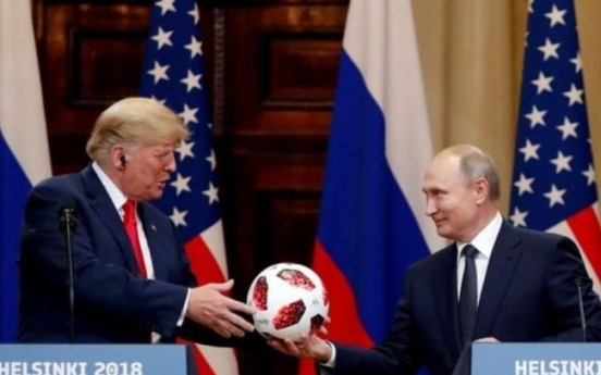 Shock, alarm as Trump backs Putin on election meddling at summit