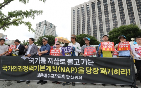 Christian, civic groups protest government human rights plan