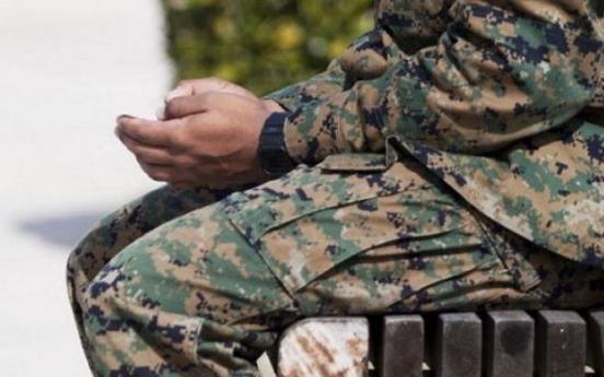 Marine injures and robs pedestrian