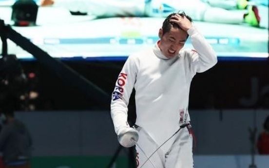 Ex-Olympic champ fencers chase team gold after losing individual titles
