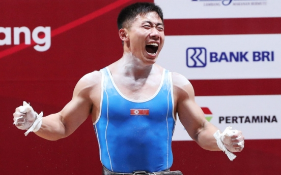 North Korea's O Kang-chol wins gold in men's 69kg weightlifting