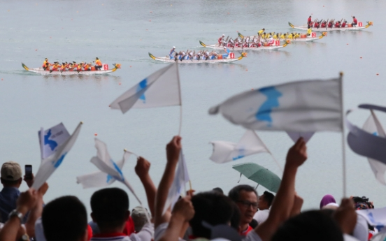 Unified Korean canoeing team wins gold in women's 500m dragon boat racing