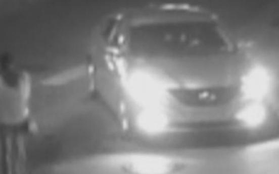 Suspect caught on CCTV ramming car into woman twice