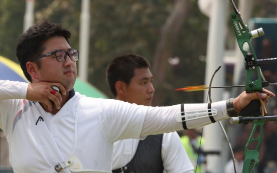 Kim Woo-jin wins gold in men's recurve archery