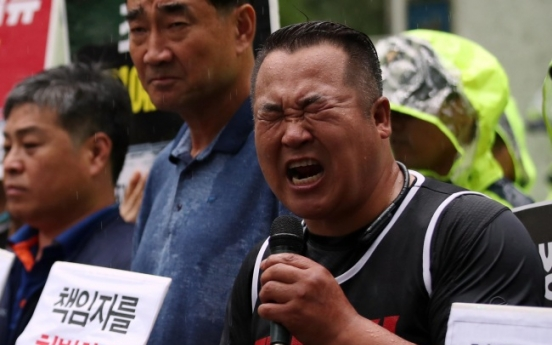 [Newsmaker] Laid-off SsangYong workers blame ex-president  for colleagues' deaths