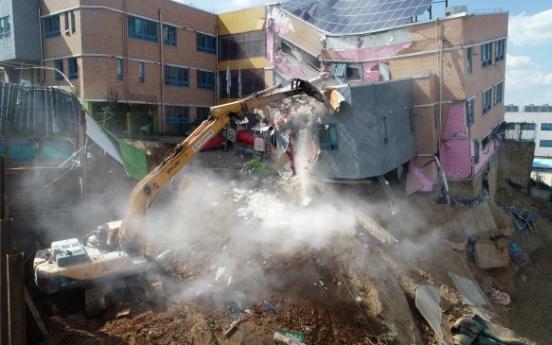 Authorities begin demolition of collapsing kindergarten