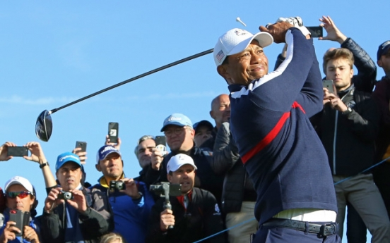 Happy times for Tiger Woods heading to a Ryder Cup