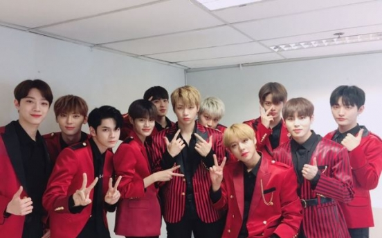 Wanna One's agency apologizes for manager's violent act toward fan