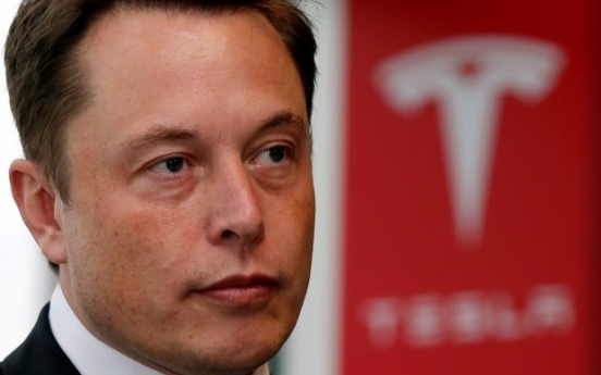 Tesla shares surge in premarket trading