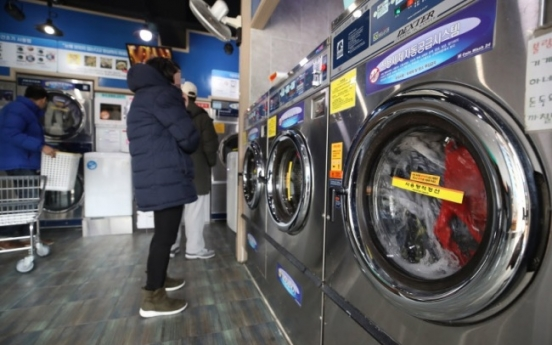Teen rescued after being trapped in washing machine
