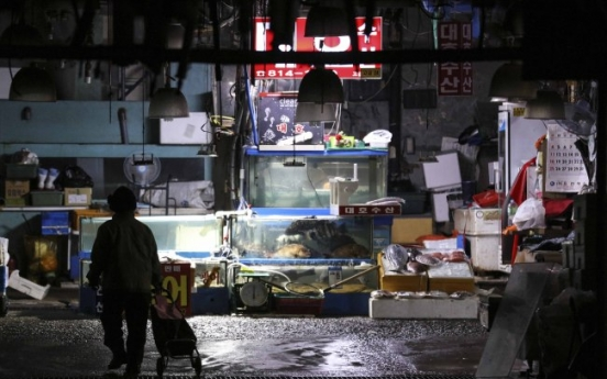 Fishmongers refuse to move out of old market despite power, water cuts