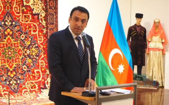 Azerbaijani carpets show hypnotic patterns, delicate hues
