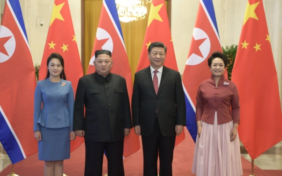 Kim reaffirms commitment to denuclearization in meeting with Xi