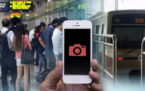 Police officer arrested for taking photos of woman in subway