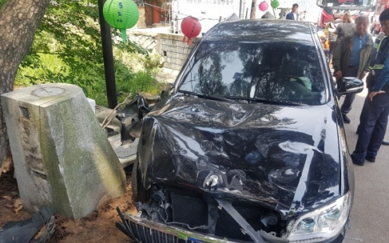 One dead, 12 injured, as car drives into crowd at Tongdosa Temple on Buddha's Birthday